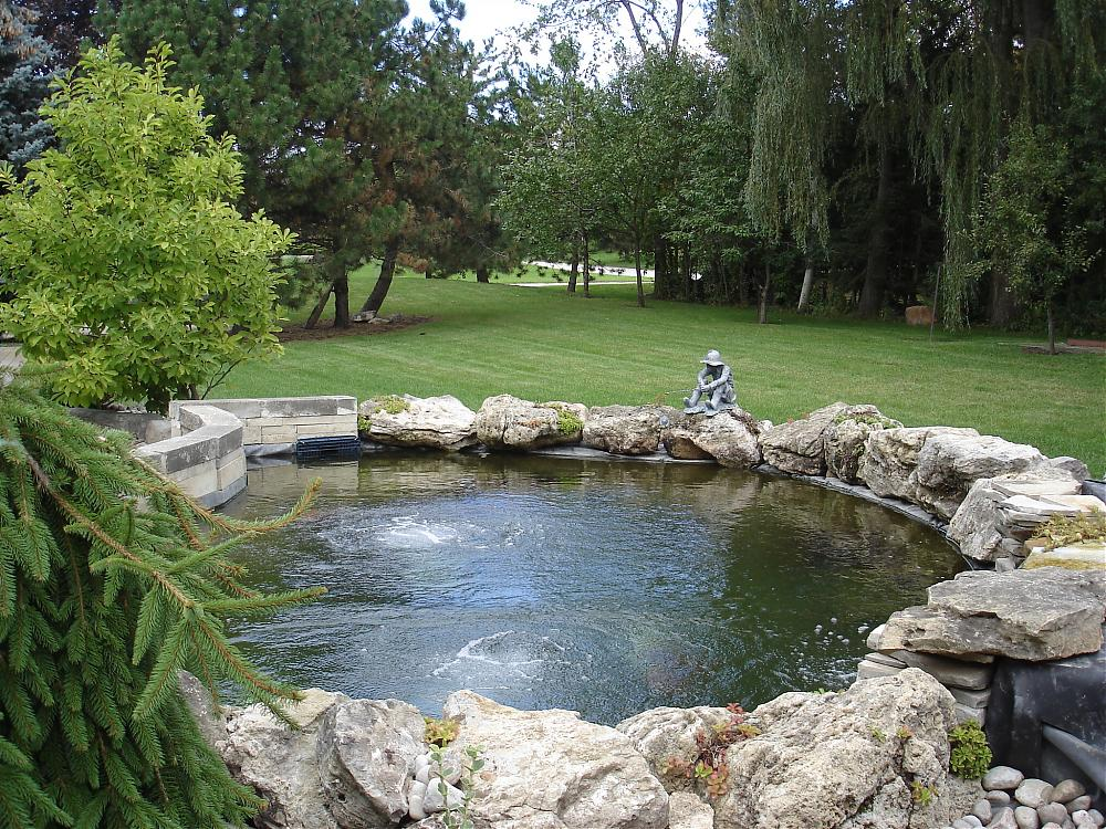 How to design for boulders with block wall for Koi pond builders mn