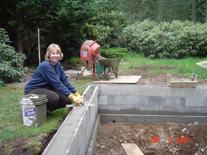 How much concrete does a block wall take for Koi pond construction cost