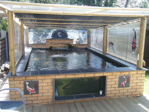 Greenhouse over my pond for Koi pond greenhouse