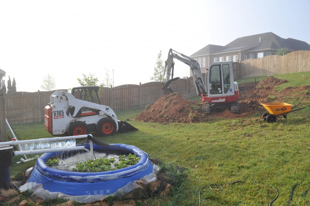 Using portable pool as temporary pond for Koi pond builders east rand