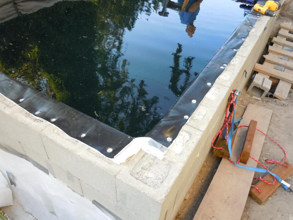 Topping off a concrete block liner pond for Cinder block koi pond