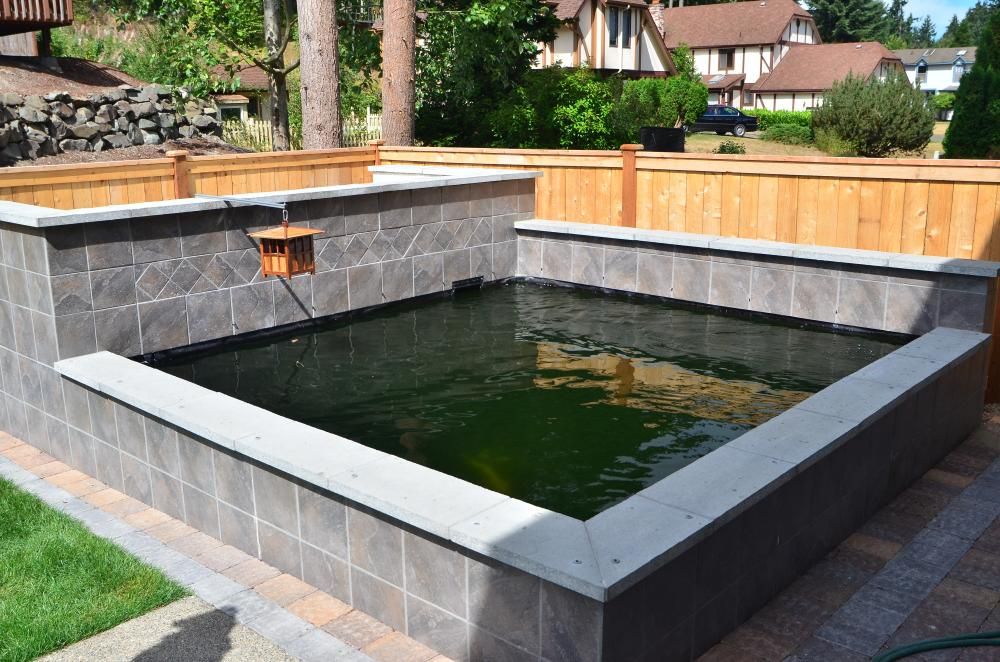 Topping off a concrete block liner pond for Concrete pond